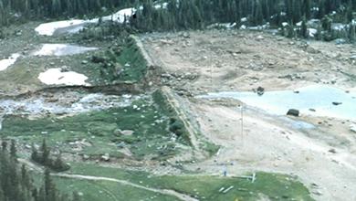 Lawn Lake Dam: Pre-Failure Comprehensive Dam Safety Evaluation and Post Failure Impacts